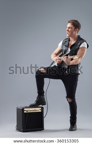 Crazy musical performer is making great music - stock photo