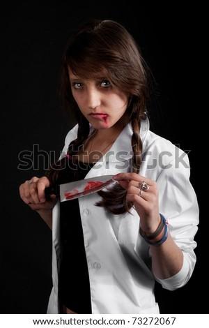crazy nurse holds a bloody knife - stock photo