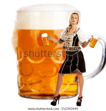 crazy oktoberfest creation with a very beautiful tiroler girl serving beer - stock photo