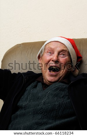 Crazy old senior man acting santa claus