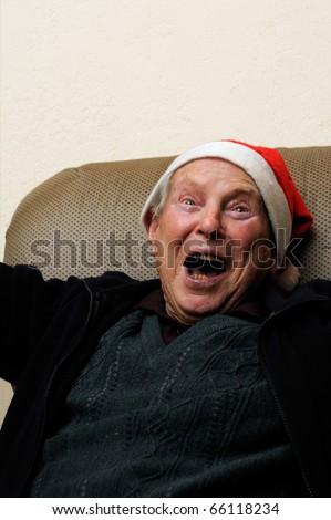 Crazy old senior man acting santa claus - stock photo