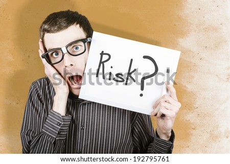 Crazy portrait of a overwhelmed office worker holding up white board with risk text when calculating worst case scenario - stock photo