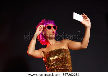 crazy purple wig girl selfie smartphone with fun glasses on black background