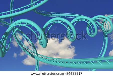 crazy rollercoaster trails against blue sky - stock photo