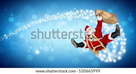 crazy santa claus on his sleigh hilarious fast funny crazy xmas christmas gift present delivery blue wide panorama bokeh background