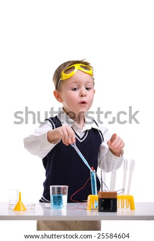 Crazy scientist. Young boy performing experiments with battery and small lamp. - stock photo