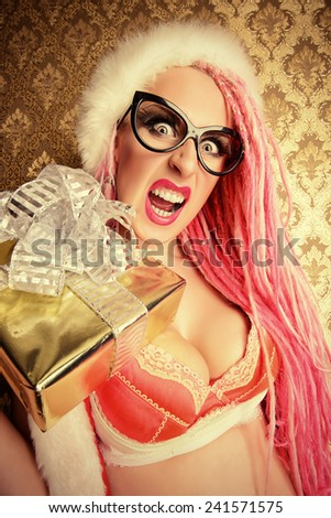 Crazy sexy girl wearing pink lingerie and pink hair alluring in the Christmas decoration.  - stock photo