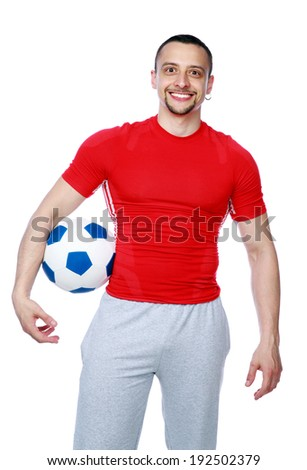 Crazy sportive man holding soccer ball over white background - stock photo