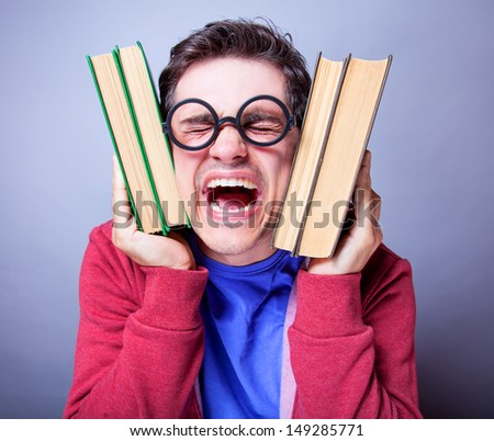 Crazy student with books. - stock photo