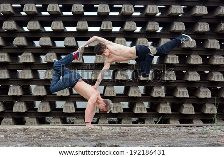 Crazy teenagers dancing break dance on the rails - stock photo