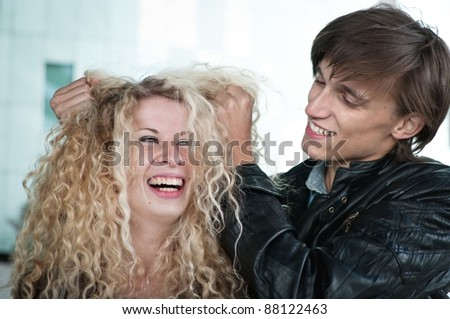 Crazy time - couple playing with hair - stock photo