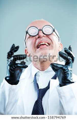 Crazy weird scientist exulting - stock photo