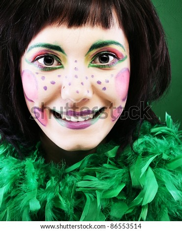 crazy woman with creative visage - stock photo