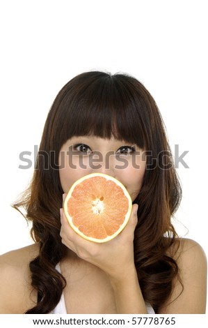 Crazy woman with one piece of lime on her eyes isolated