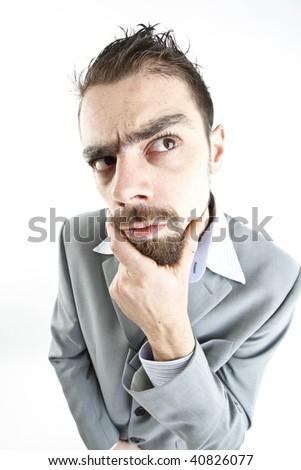 crazy young businessman facial expression - stock photo