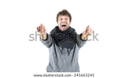 crazy young man pointing forward - stock photo