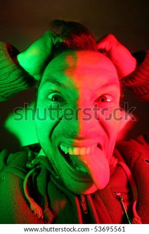 crazy young man, portrait shoot, fashion shoot (color flashes) - stock photo