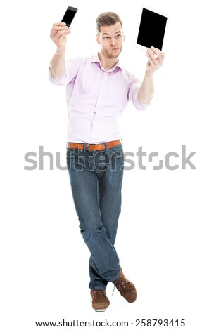 Crazy young man taking selfie with tablet and smartphone at same time - stock photo