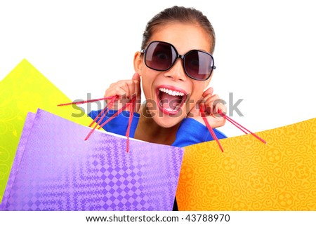 Crazy young woman on a shopping spree. Isolated on white background. - stock photo
