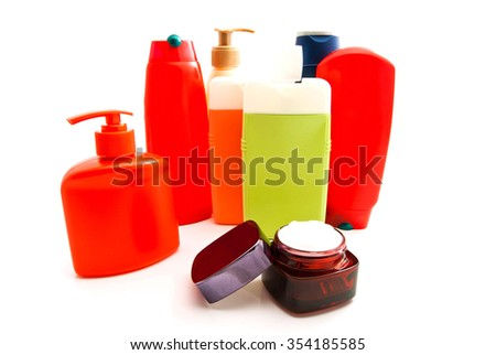 cream and colored bottles with gel on white background