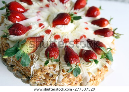 Cream and strawberries cake on perspective  - stock photo
