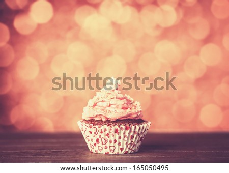 Cream cake on wooden table. Photo in retro color style - stock photo