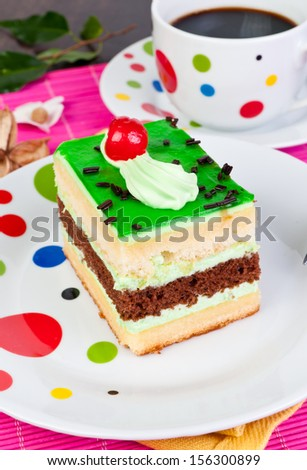 cream cake with green glass on plate
