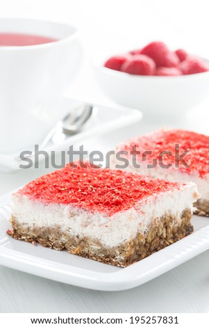 cream cakes with raspberries, selective focus, vertical