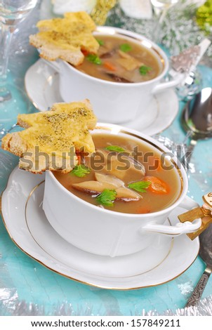 cream cep soup with  christmas tree`s shape cheese toast on festive table - stock photo