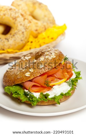 Cream cheese and smoked salmon bagel. Selective focus. - stock photo