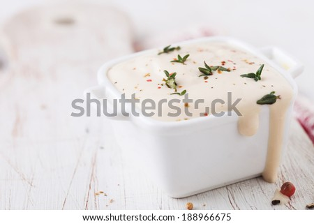 Cream cheese white sauce in the bowl - stock photo