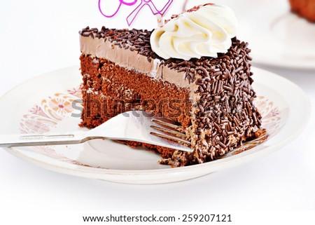 cream chocolate cake with fork - stock photo