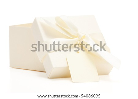 cream colored gift box with attached bow and name tag; white background - stock photo