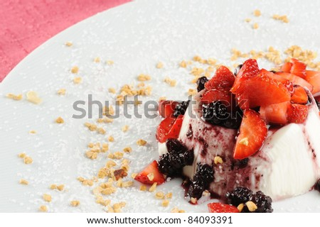 cream cooked with various berries and hazelnut - stock photo