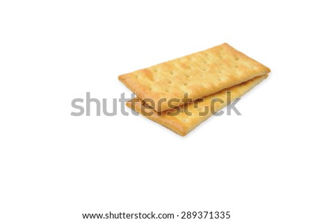Cream Crackers biscuit isolated on white background.Slightly defocused and close-up shot - stock photo