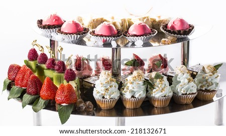 cream dessert and fruit on a table in a restaurant - stock photo