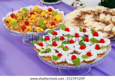 cream desserts with canapes on a plate in a restaurant - stock photo