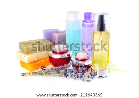 Cream, handmade soaps with lavender flowers and group of lotions in bottles on white background