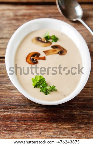 Cream Homemade Mushroom Soup In A White Plate With Parsley