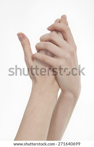 cream is rubbed into the hands - stock photo