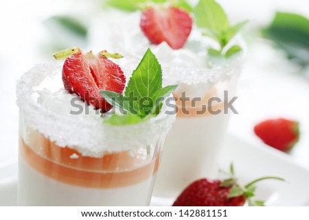 cream jelly with strawberries in a glass