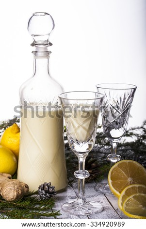 cream liqueur with lemon and ginger on a white background