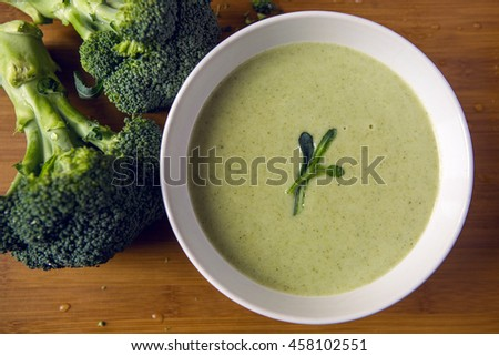 Cream Of Broccoli Soup In A White Bowl On A Wooden Table With Slices Of The