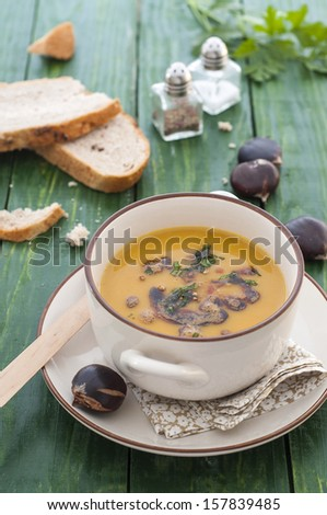 Cream of carrots and chestnut soup - stock photo