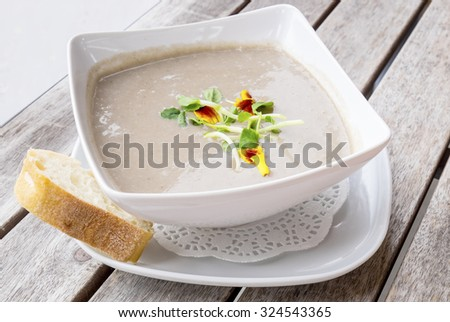 Cream of Mushroom Soup with a Slice of Baguette Bread - stock photo
