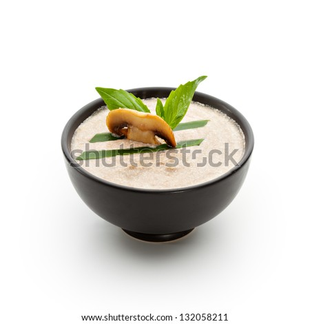 Cream of Mushroom Soup with Lettuce and Basil Leaf - stock photo