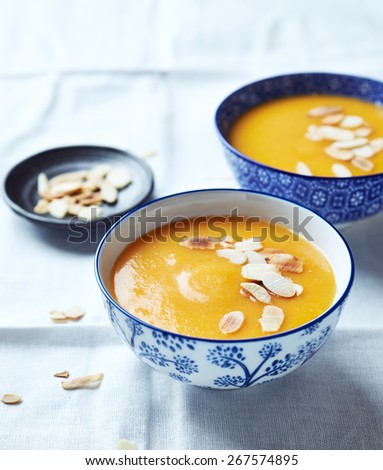 Cream of pumpkin soup with roasted almonds  - stock photo