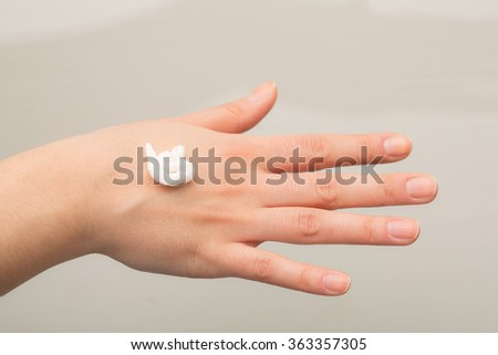 Cream on hand - stock photo