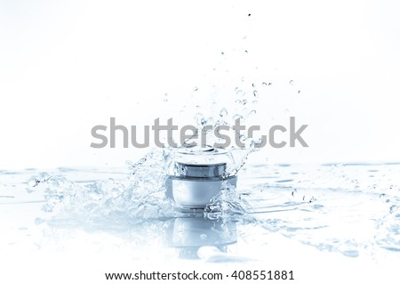 Cream pot and water splash. Concept beauty and fresh