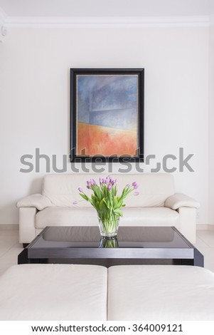 Cream sofa and black table in sitting room - stock photo